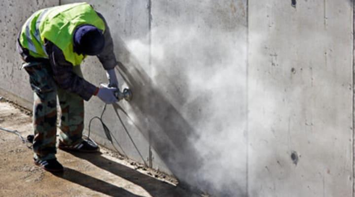 Thi công mài tường xây bê tông